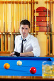Billiard expertise man posing on blue Stock Photos