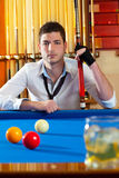 Billiard expertise man posing on blue Royalty Free Stock Photos