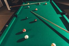 Billiard gambling table with cues. And balls royalty free stock photos