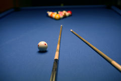 Billiard Game. Billiard blue table with balls and cue in beginning position Stock Photos