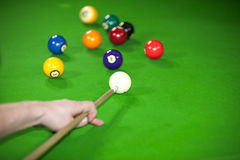 Billiard game situation. A billiard game situation with the billiard player being ready to hit the white ball to touch the red ball number three Stock Images