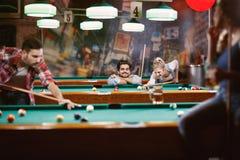 Billiard games - friends enjoying playing pool together. Billiard games -Happy friends enjoying playing pool together royalty free stock photography