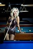 Billiard girl. A young  woman playing billiard Stock Photo