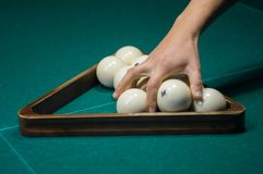 Billiard green table in hall with white balls Stock Photos