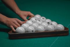 Billiard green table in hall with white balls Stock Photo