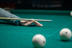 Billiard green table in hall with white balls Royalty Free Stock Photos