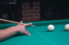 Billiard green table in hall with white balls Royalty Free Stock Image