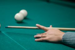 Billiard green table in hall with white balls Stock Image