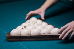 Billiard green table in hall with white balls Stock Images