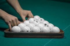 Billiard green table in hall with white balls Royalty Free Stock Photo