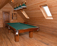 The billiard hall on a mansard floor of the guest house Stock Images