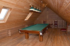 The billiard hall on a mansard floor of the guest house.  Royalty Free Stock Images