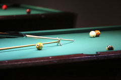 Billiard. hand with cue prepare hit a ball Royalty Free Stock Image
