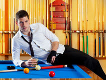 Billiard handsome player man drinking alcohol. Billiard handsome player man drinking some alcohol in club Stock Image
