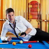 Billiard handsome player man drinking alcohol Stock Photography