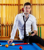 Billiard handsome player man drinking alcohol Stock Images