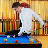 Billiard handsome young man with shirt cue and tie. Billiard winner handsome man playing with cue and balls at club stock photos