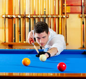 Billiard handsome young man with shirt cue and tie. Billiard winner handsome man playing with cue and balls at club Royalty Free Stock Photography
