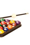 Billiard kit. Billiard balls and a cue isolated on a white background Royalty Free Stock Images