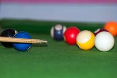 The billiard match in the Tanzania. Billiard stick and balls on the pool table stock photo