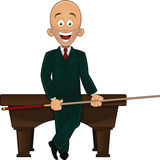 Billiard player holding cue Stock Photo