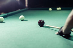 Billiard player now preparing his shot the ball. In special gloves Royalty Free Stock Images