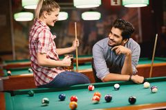 Billiard playing - couple dating and playing snooker stock photo