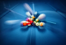 Billiard pool. Blue billiard table with colorful balls, beginning of game, slow motion, soft focus, snooker bar, entertainment in nightclub, hobby and sport stock image