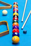Billiard pool game balls lined up on billiard table. With blue cloth with cues, racks, and chalk Stock Images