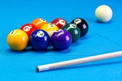 Billiard pool game nine ball setup with cue on billiard table Stock Photography