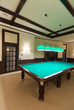 Billiard or pool table. In spacious modern room Royalty Free Stock Images