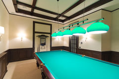 Billiard or pool table. In spacious modern room Royalty Free Stock Image