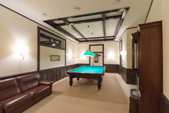 Billiard or pool table. In spacious modern room Royalty Free Stock Photography