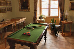 Billiard or pool table and other games in Biedermeier style. Rozumberk Castle (south of Prague), Czech Republic - August 2, 2015: The historical pool or billiard stock photos