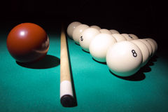 Billiard pyramid on light beam. Pool balls on light beam. Balls pyramid with number 8 ball on a foreground Stock Photo