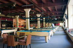 Billiard room with many tables Royalty Free Stock Images