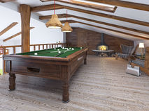 Billiard room with two comfortable chairs and a fireplace in the Royalty Free Stock Image