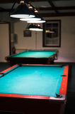 In the billiard room, two empty table Stock Photography