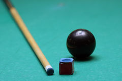 Billiard set. Ball, chalk and a stick for billiard game Royalty Free Stock Photos