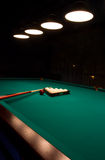 Billiard set on green table Stock Photo