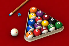 Billiard set on red. Racked pool balls, a cue stick and a pool chalk block on a red table (3D rendering Stock Images