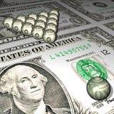 Billiard spheres on a dollar background. Royalty Free Stock Photos