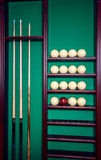 billiard stand with cues and balls Stock Images