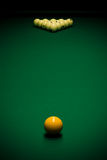 Billiard table. Yellow sphere on a billiard table in a night club Royalty Free Stock Image