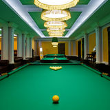 Billiard table. Yellow sphere on a billiard table in a night club royalty free stock photography