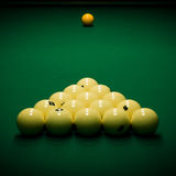 Billiard table. Yellow sphere on a billiard table in a night club royalty free stock photos