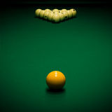 Billiard table. Yellow sphere on a billiard table in a night club stock photos
