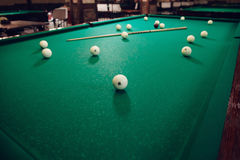 Billiard table. Billiard able with balls and stick on it Stock Images