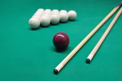 Billiard table with balls, cue and chalk for him.  Royalty Free Stock Photos