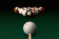 Billiard table with balls set and cue Stock Photography